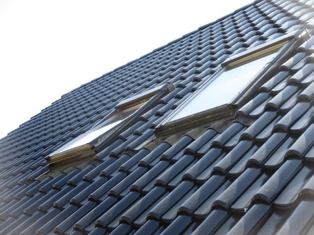 nieuwe-pannen-met-bestaande-dakvensters